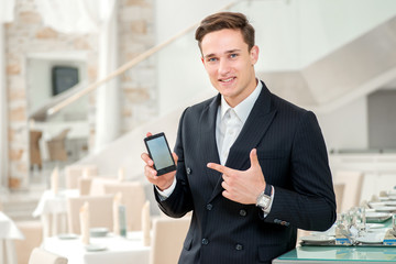 Mobile phone a friend for businessman. Confident and successful