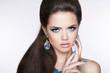 Beautiful Brunette Girl. Makeup. Woman with fashion earrings. Ma