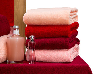 a neat stack of terry towels on a rack isolated on white