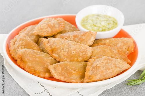 Empanadas - Spanish fried pasty filled with chorizo and cheese - 69886923