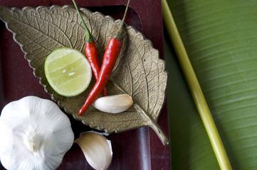 close up spices on golden leaf