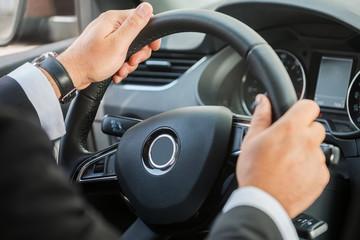 Man steering wheel.