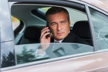 Business talk in car.