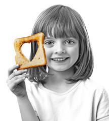 little girl holding  bread on white background