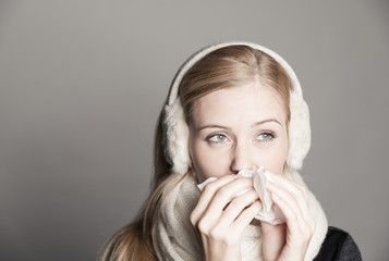 young woman having a bad cold
