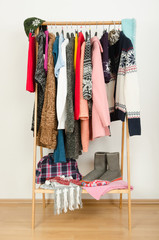 Wardrobe with winter clothes and accessories nicely arranged.