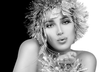 Party Girl Sending a Kiss. Christmas Woman with Silver Stylism.