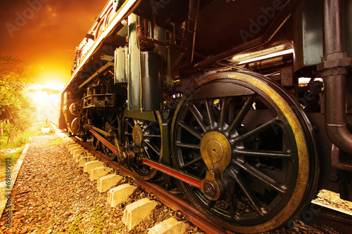 iron wheels of stream engine locomotive train on railways track