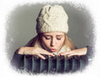 canvas print picture - young blonde woman wearing a bonnet in winter