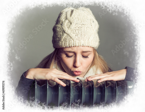 canvas print picture young blonde woman wearing a bonnet in winter