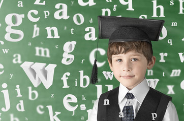 smart boy with flying letters, studio shot