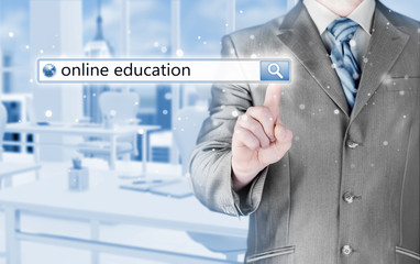 Online education written in search bar on virtual screen.