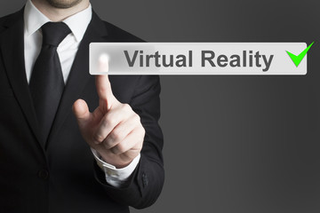 businessman pushing button Virtual Reality