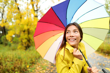 Autumn / fall - woman happy with umbrella in rain