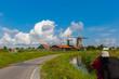 Photographer takes windmills in Zaanse Schans, Holland, Netherla