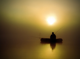 Fishermen in the morning mist