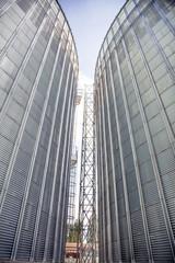 Background, metal barrels granaries on the sky background