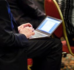 Businessman on conference with ultrabook