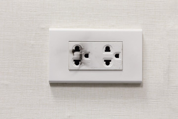 burning electric plug socket on the wall