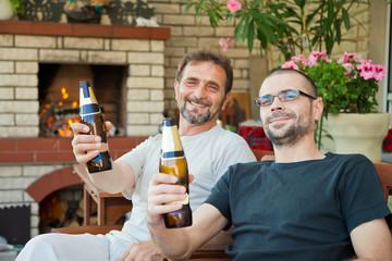 happy men with beer bottles