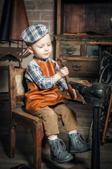 Boy playing with hammer and shoe