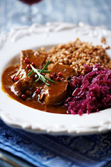 Roast pork in dark sauce with red cabbage and buckwheat
