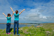 Kids looking at beautiful sea view, family hiking on vacation