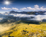 Colac mountain range at foggy summer morning. Dolomites mountain