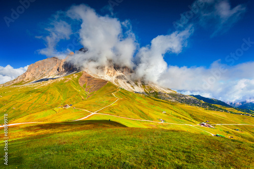 Sassolungo mountain range at sunny summer day.  Dolomites mounta