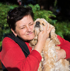 Happy senior woman with american spaniel