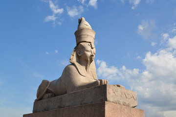 Ancient Egyptian sphinx in St. Petersburg against the blue sky