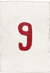 number nine on white plywood board