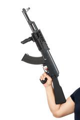 hand holding AK-47 machine gun isolated on white