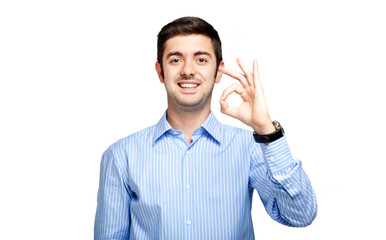 Young man showing ok sign