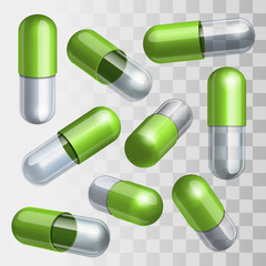 Set of green and transparent medical capsules in different