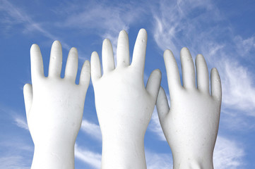 White Molded Hands Reaching to the Sky