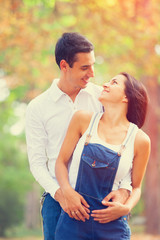 Teen couple in the park in autumn time