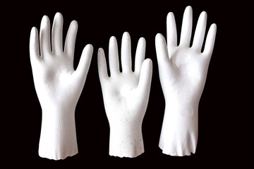 Three White Molded Raised Hands on Black Background