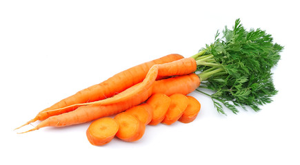 Sweet carrots with leafs on white