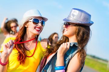 Two young girlfriends having fun
