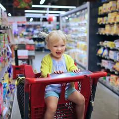Little girl doing shopping in supermarket