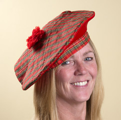 Portrait of a woman wearing a Tam o Shanter Scottish hat