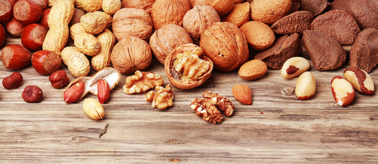 Variety of shelled and whole nuts in a banner