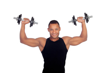 Handsome muscled man training with dumbbells