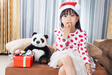 Little Girl With a Plate of Cookies for Santa