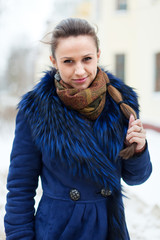 woman  wearing  coat at wintry city