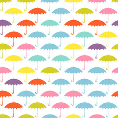 Seamless pattern with colored umbrellas on a white background.