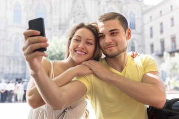 Couple doing selfie at the street