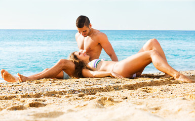 Happy  lovers  at sandy beach