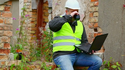 Construction Engineer working with PC and drinking tea